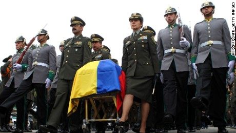 Colombian National Police director Rodolfo Palomino (3-L) carries with other officers the coffin with the remains of Mayor German Olinto M?ndez Pabon, during funeral honors in Bogota on March 20, 2014. Two policemen were found dead Tuesday in the town of Tumaco, Nari?o Department, three days after having been abducted in that area in the southwest of Colombia, officials said, which attributed these events to the FARC guerrillas. AFP PHOTO/Felipe Caicedo        (Photo credit should read Felipe CAICEDO/AFP/Getty Images)