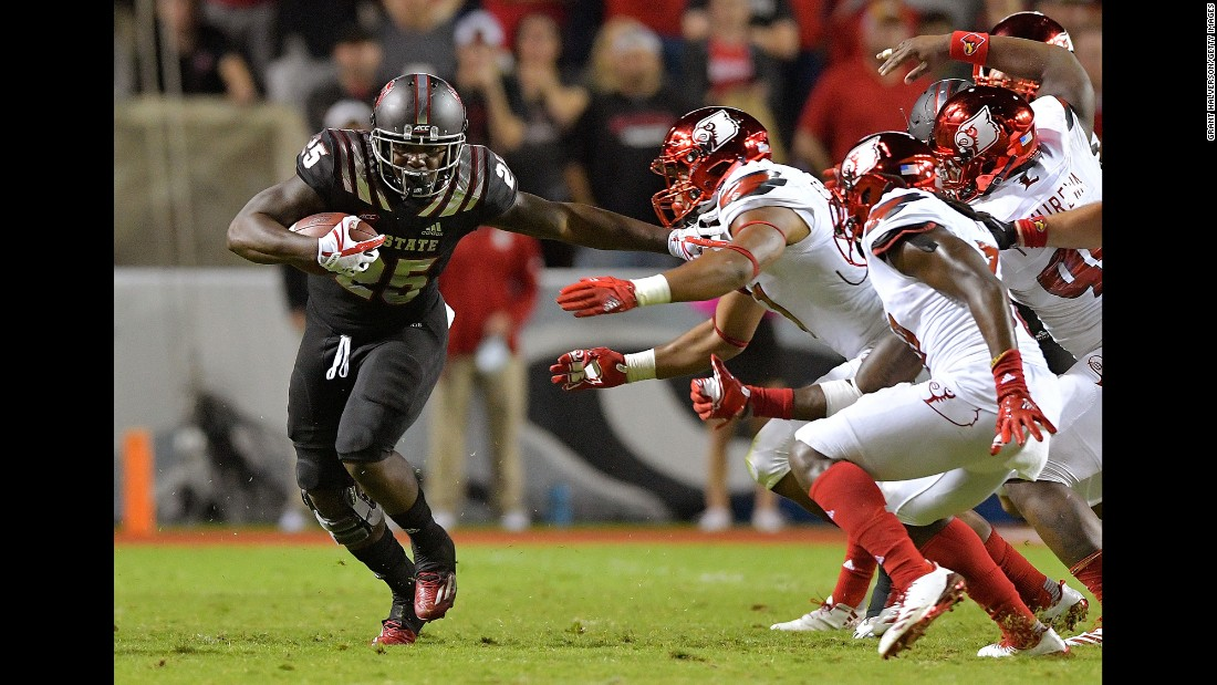 Reggie Gallaspy II, #25, of the North Carolina State Wolfpack runs against the Louisville Cardinals on Thursday, October 5, in Raleigh, North Carolina. North Carolina State won 39-25.