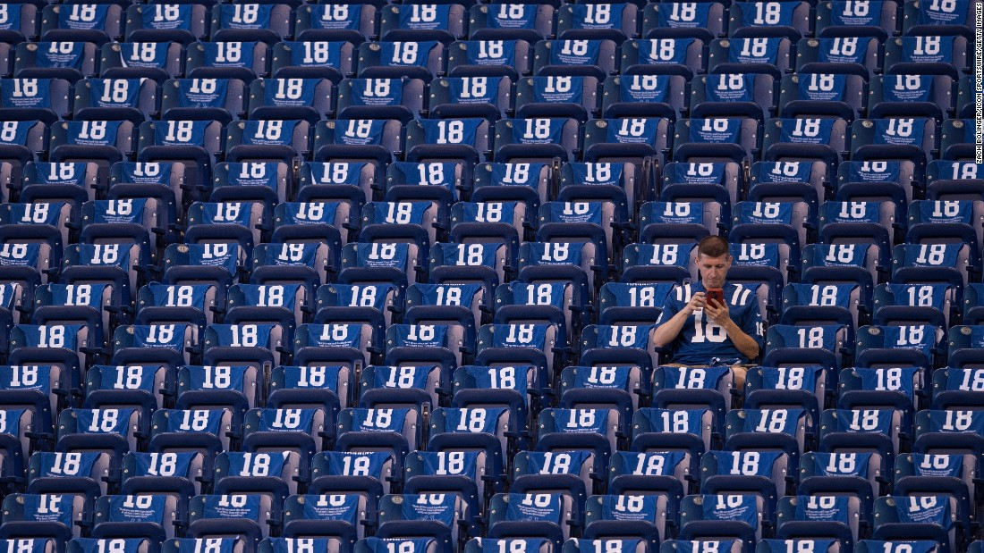 "An Indianapolis Colts fan sits in the stands surrounded by towels honoring Peyton Manning before the NFL game between the San Francisco 49ers and Indianapolis Colts on Sunday, October 8, in Indianapolis. The Colts unveiled a <a href=""http://bleacherreport.com/articles/2737436-peyton-manning-statue-unveiled-outside-of-colts-lucas-oil-stadium"" target=""_blank"">statue in Manning's honor</a> at the game and retired his number."