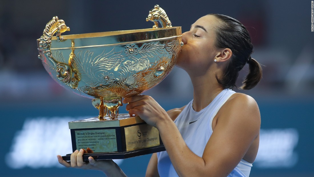 Caroline Garcia of France kisses her trophy after winning the Women's Singles finals match against Simona Halep of Romania on day nine of the 2017 China Open at the China National Tennis Centre on Sunday, October 8, in Beijing.