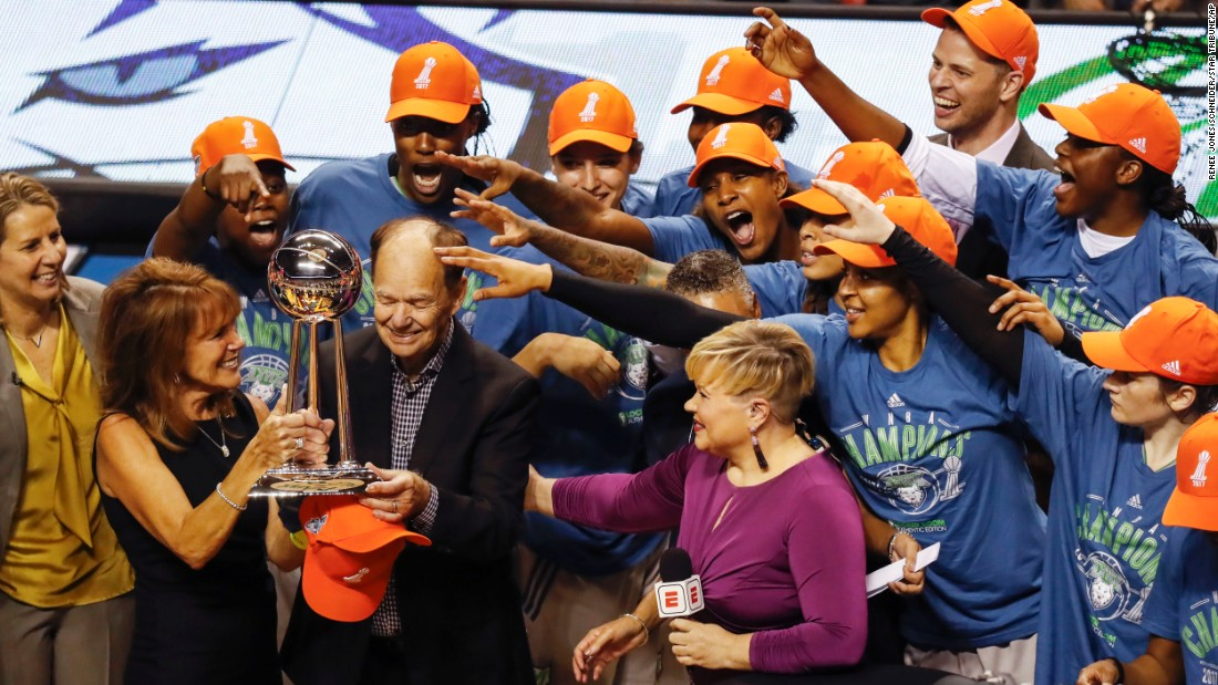 Minnesota Lynx team owner Glen Taylor accepts the WNBA championship trophy as Lynx players celebrate their WNBA finals win, on Wednesday, October 4, in Minneapolis.