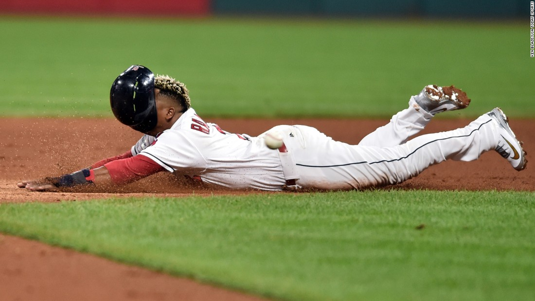 The helmet of Cleveland Indians third baseman Jose Ramirez slides off his head as he steals second base during the fifth inning against the New York Yankees in game one of the 2017 on Thursday, October 5 in Cleveland.