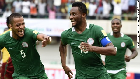 Nigeria's Mikel John Obi (C) celebrates with teammates William Ekong (L) and Odion Ighalo after scoring a goal during the 2018 FIFA World Cup qualifying football match between Nigeria and Cameroon at Godswill Akpabio International Stadium in Uyo, southern Nigeria, on September 1, 2017. / AFP PHOTO / PIUS UTOMI EKPEI        (Photo credit should read PIUS UTOMI EKPEI/AFP/Getty Images)
