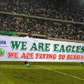 nigeria players celebrate world cup qualification banner