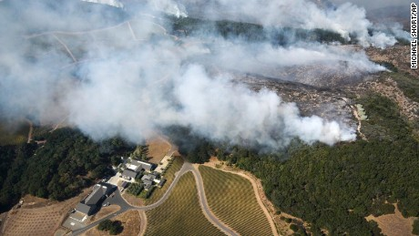 Smoke rises as a wildfire burns near Kenzo Estate in Napa, Calif., Monday, Oct. 9, 2017. Wildfires whipped by powerful winds swept through Northern California sending residents on a headlong flight to safety through smoke and flames as homes burned.