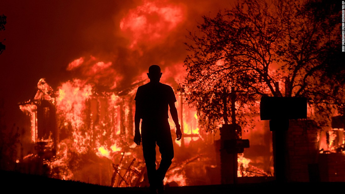Jim Stites watches as part of his neighborhood burns in Fountaingrove on October 9.