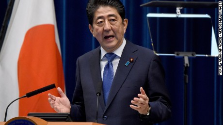 Japan's Prime Minister Shinzo Abe gestures as he speaks during a press conference at his official residence in Tokyo on September 25, 2017.