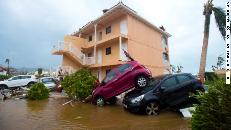 TOPSHOT - A photo taken on September 6, 2017 shows cars piled on top of one another in Marigot, near the Bay of Nettle, on the French Collectivity of Saint Martin, after the passage of Hurricane Irma. France, the Netherlands and Britain on September 7 sent water, emergency rations and rescue teams to their stricken territories in the Caribbean hit by Hurricane Irma, which has killed at least 10 people. The worst-affected island so far is Saint Martin, which is divided between the Netherlands and France, where eight of the 10 confirmed deaths took place.  / AFP PHOTO / Lionel CHAMOISEAU        (Photo credit should read LIONEL CHAMOISEAU/AFP/Getty Images)