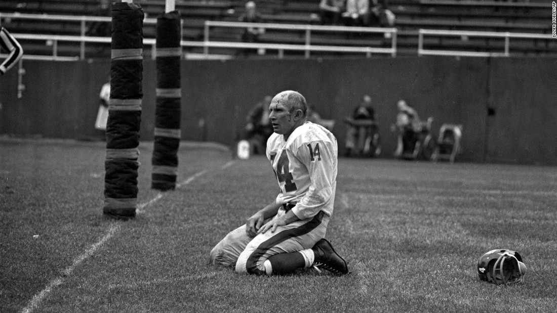 "Hall of Fame football quarterback <a href=""http://bleacherreport.com/articles/2737727-pro-football-hall-of-fame-qb-ya-tittle-dies-at-age-90"" target=""_blank"">Y.A. Tittle </a>died Sunday, October 8, at the age of 90. Tittle made the Pro Bowl seven times over his 17-year career, and he was the NFL's MVP in 1963. In this photo, Tittle squats on the field after being hit hard during a game against the Pittsburgh Steelers in 1964. This became an iconic photograph that helped cement Tittle's name in football history."