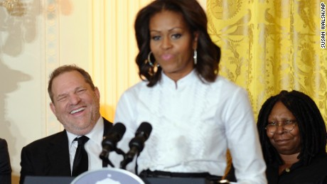 Movie mogul Harvey Weinstein, left, and Academy Award winning actress Whoopie Goldberg, listen as first lady Michelle Obama speaks in the East Room of the White House in Washington, Friday, Nov. 8, 2013, at a workshop for high school students from Washington, New York and Boston about careers in film.