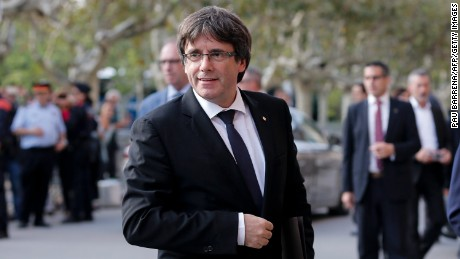 Catalan regional government president Carles Puigdemont arrives to address the Catalan regional parliament in Barcelona on October 10, 2017. Spain's worst political crisis in a generation will come to a head as Catalonia's leader could declare independence from Madrid in a move likely to send shockwaves through Europe.