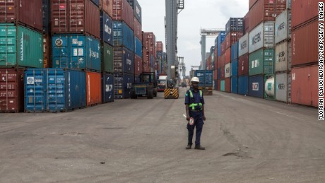 A member of the security stands among containers at the Lagos Tin-Can Island container terminal in Apapa, on October 7, 2015. Tin Can Island Port is Nigerias second largest seaport about seven kilometers due west of the city centre of Lagos across Lagos harbor. AFP PHOTO/FLORIAN PLAUCHEUR        (Photo credit should read FLORIAN PLAUCHEUR/AFP/Getty Images)