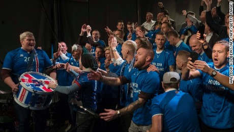 Iceland's national team football players and coaching staff celebrate with fans at Ingolfstorg square in the centre of Reykjavik after the FIFA World Cup 2018 qualification football match against Kosovo in Reykjavik, Iceland on October 9, 2017. Iceland qualified for the FIFA World Cup 2018 as smallest country ever after beating Kosovo 2-0 at home in Reykjavik. / AFP PHOTO / Halldor KOLBEINS        (Photo credit should read HALLDOR KOLBEINS/AFP/Getty Images)