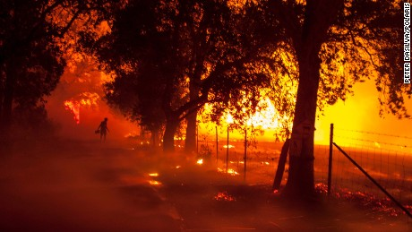 Wildfires tear across California