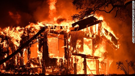 Flames ravage a home in the Napa wine region as wind-driven fires continue to whipping the area.
