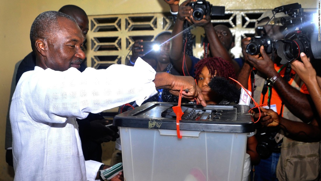 Liberian presidential candidate Alexander Cummings casts his ballot. He is one of 20 candidates vying for the presidency. <br />Credit: Getty images