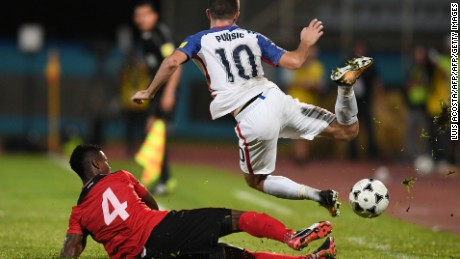 USA's Christian Pulisic (R) is marked by Trinidad and Tobago's Kevon Villaroel during their 2018 World Cup qualifier football match in Couva, Trinidad and Tobago, on October 10, 2017. / AFP PHOTO / Luis ACOSTA        (Photo credit should read LUIS ACOSTA/AFP/Getty Images)