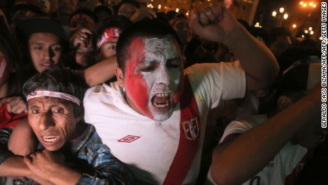 Peruvian football fans celebrate after a draw at their 2018 World Cup football qualifier match against Colombia at the National Stadium in Lima, on October 10, 2017. Peru still hopes to qualify for 2018 World Cup football tournament. / AFP PHOTO / Geraldo Caso Bizama        (Photo credit should read GERALDO CASO BIZAMA/AFP/Getty Images)