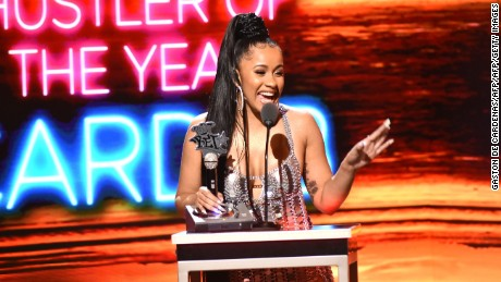 Rapper Cardi B receives the award for Hustler of the Year during the BET Hip Hop Awards 2017 in Miami Beach, Florida.