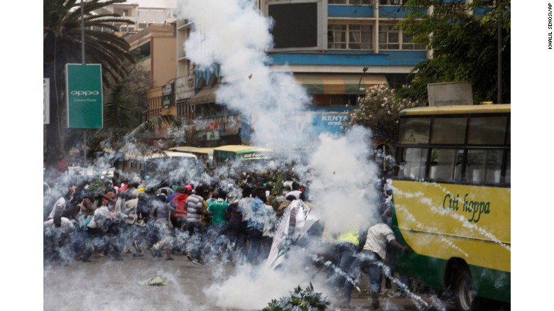 Riot police use tear gas on opposition supporters during an October 11 protest in Nairobi.