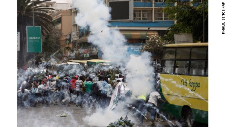 Riot police fire teargas against opposition supporters during a demonstration against the Independent Electoral and Boundaries Commission (IEBC) in Nairobi, Kenya, Wednesday, Oct. 11, 2017. The protesters are demanding a change of leadership at the country's election commission. The protests took place in the capital Nairobi and the opposition stronghold of Kisumu, in western Kenya, as well as in the coastal city of Mombasa.