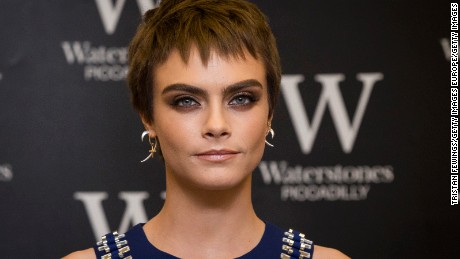 Cara Delevingne attends the signing of her debut Young Adult novel 'Mirror, Mirror' at Waterstones Piccadilly on October 4, 2017 in London, England.  (Photo by Tristan Fewings/Getty Images)