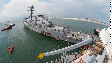 The guided-missile destroyer USS John S. McCain prepares to load aboard the heavy lift transport M/V Treasure off Singapore.