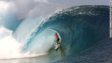 Australia's Mick Fanning rides a wave on August 18, 2014 during the 14th edition of the Billabong Pro Tahiti surf event, part of the ASP (Association of Surfing Professionals) world tour, in Teahupoo, on the French Polynesian island Tahiti. AFP PHOTO / GREGORY BOISSY        (Photo credit should read GREGORY BOISSY/AFP/Getty Images)