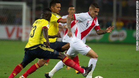 Peru's Paolo Guerrero (R) fights for the ball with Colombia's Davinson Sanchez (L) and Abel Aguilar during their 2018 World Cup qualifier football match in Lima, on October 10, 2017. / AFP PHOTO / Ernesto BENAVIDES        (Photo credit should read ERNESTO BENAVIDES/AFP/Getty Images)