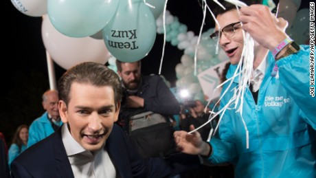 Austria's Minister for Foreign Affairs and chairman of Austrian People's Party (OeVP), Sebastian Kurz greets his supporters as he arrives at Austrian Puls 4 private television station before a campaign televised debate on October 8, 2017 in Vienna. / AFP PHOTO / JOE KLAMAR        (Photo credit should read JOE KLAMAR/AFP/Getty Images)