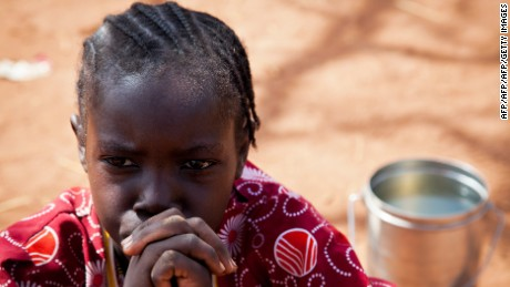 A girl from the Nuba Mountains in Sudan waits outside of the Yida refugee camp registration center in Yida, South Sudan on April 26, 2012. Thousands of people from the Nuba Mountains in South Kordofan, Sudan have fled to Yida to escape recent fighting and airstrikes by Sudan's Armed Forces (SAF).