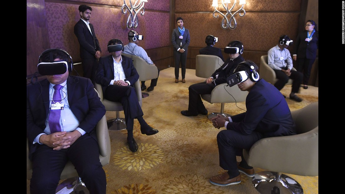 People test virtual-reality headsets at the India Economic Summit in New Delhi on Friday, October 6.