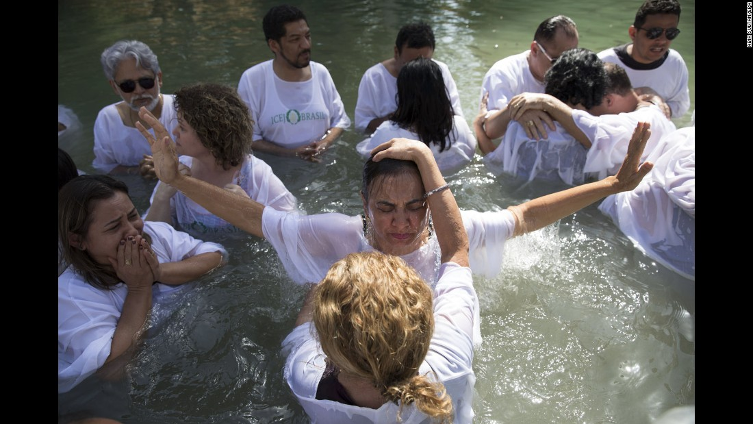 Christian pilgrims from Brazil are baptized in the Jordan River, at the Yardenit baptismal site in Israel, on Saturday, October 7.