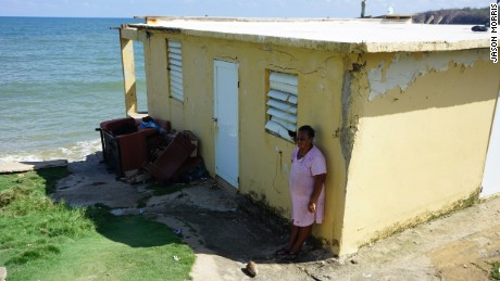 Puerto Rico hurricane victim Irma Torres outside her destroyed home in Yabucoa