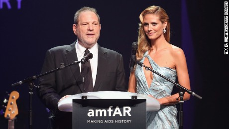 Harvey Weinstein and Heidi Klum speak onstage during amfAR's 21st Cinema Against AIDS Gala Presented By WORLDVIEW, BOLD FILMS, And BVLGARI at Hotel du Cap-Eden-Roc on May 22, 2014 in Cap d'Antibes, France.