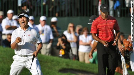 Y.E. Yang of South Korea after sinking his putt to win August 16 ,2009 at the 91st PGA Championship at the Hazeltine National Golf Club in Chaska, Minnesota.  At right is Tiger Woods of the US . AFP PHOTO / ROBYN BECK (Photo credit should read ROBYN BECK/AFP/Getty Images)