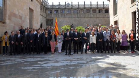 "President of the Catalan regional government Carles Puigdemont (C) speaks flanked by president of the Catalan parliament Carme Forcadell (CL), Catalan regional vice-President and chief of Economy and Finance, Oriol Junqueras (CR) and all the members of the Catalan regional governement, and deputies of political parties ""Junts pel Si"" and ""CUP"", to announce that the referendum on independence will be held on October 1, 2017 at the Palau de La Generalitat in Barcelona on June 9, 2017. The leader of Spain's Catalonia region, where a separatist movement is in full swing, today announced an independence referendum for October 1 in defiance of Madrid which is firmly against such a vote.   / AFP PHOTO / LLUIS GENE        (Photo credit should read LLUIS GENE/AFP/Getty Images)"