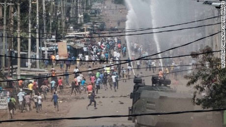 Police spray water cannons to disperse opposition protesters last week in Kisumu, Kenya.