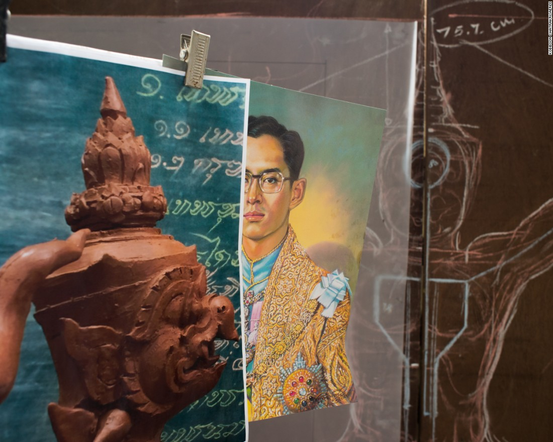 "An image of the king as a young man on display at a government art studio outside Bangkok. ""When we are working, we always think of His Majesty,"" said sculptor Chatmongkol Insawang."