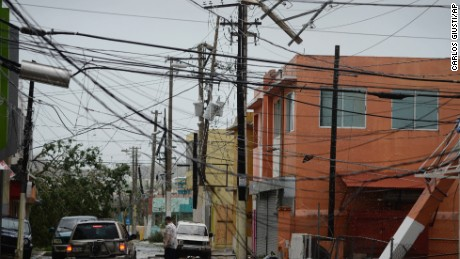 "FILE - In this Wednesday, Sept. 20, 2017 file photo, power lines are down after the impact of Hurricane Maria, which hit the eastern region of the island in Humacao, Puerto Rico. In the wake of Hurricane Maria, Facebook pledged to send a ""connectivity team"" to help restore communications in ravaged Puerto Rico. It's just one of several tech companies - among them Tesla, Google, Cisco, Microsoft and a range of startups - with their own disaster response proposals, most aimed at getting phone and internet service up and running. (AP Photo/Carlos Giusti, File)"