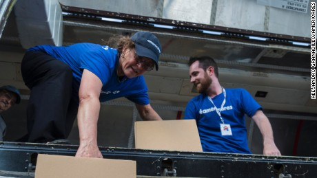 Americares Senior Vice President of Global Programs Dr. E. Anne Peterson helps unload a planeload of medicine and supplies by hand in San Juan on October 1, 2017.