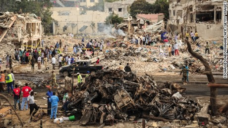A picture taken on October 15, 2017 shows a general view of the scene of the explosion of a truck bomb in the centre of Mogadishu. A truck bomb exploded outside a hotel at a busy junction in Somalia's capital Mogadishu on October 14, 2017 causing widespread devastation that left at least 20 dead, with the toll likely to rise.