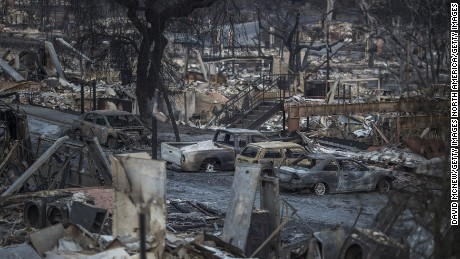 SANTA ROSA, CA -OCTOBER 14: The ruins of houses destroyed by the Tubbs Fire are seen near Fountaingrove Parkway on October 14, 2017 in Santa Rosa, California. At least 40 people are confirmed dead with hundreds still missing. Officials expect the death toll to rise, and now estimate that 5,700 structures have been destroyed. (Photo by David McNew/Getty Images)