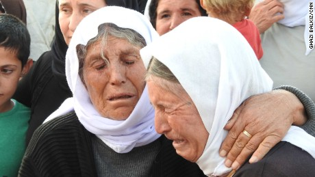 Elderly Yazidi women weep over their sons and daughters who remain in captivity.