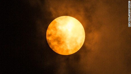 UNSPECIFIED, UNITED KINGDOM - OCTOBER 16:  The sun goes a golden yellow colour due to dust from the Sahara being blown in with Storm Ophelia on October 16, 2017 in Fulham, London, England.  (Photo by Rob Ball/Getty Images)