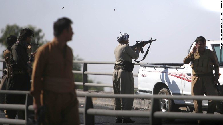 Kurdish forces open fire on Iraqi troops in the streets in Kirkuk on Monday.