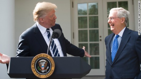 President Donald Trump speaks to the press alongside Senate Majority Leader Mitch McConnell (R), Republican of Kentucky, in the Rose Garden of the White House in Washington, DC, on October 16, 2017.