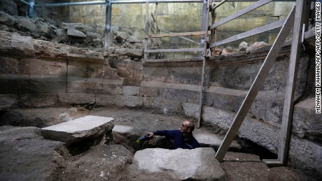 Joe Uziel, an archeologist from the Israeli Antiquity Authority, works on a recently discovered ancient roman theatre from the second sanctuary that was found at the foot of the Western Wall tunnels in Jerusalem's Old City on October 16, 2017.  Excavations conducted by the Israel Antiquities Authority have uncovered large portions of the Western Wall that have been hidden for 1,700 years.  / AFP PHOTO / MENAHEM KAHANA        (Photo credit should read MENAHEM KAHANA/AFP/Getty Images)