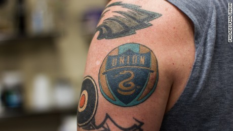 The Union's logo with a coiled snake is one of the most popular tattoos among fans