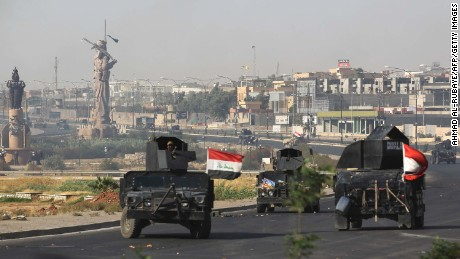 Iraqi forces advance towards the centre of Kirkuk during an operation against Kurdish fighters on October 16, 2017. 